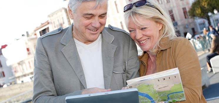 Couple reading map while on vacation